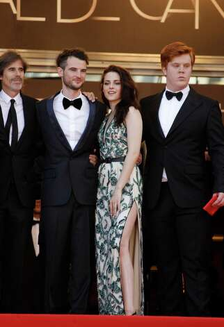 From left, director Walter Salles, actors Tom Sturridge, Kristen Stewart and Tom Sturridge arrive for the screening of On the Road at the 65th international film festival, in Cannes, southern France,