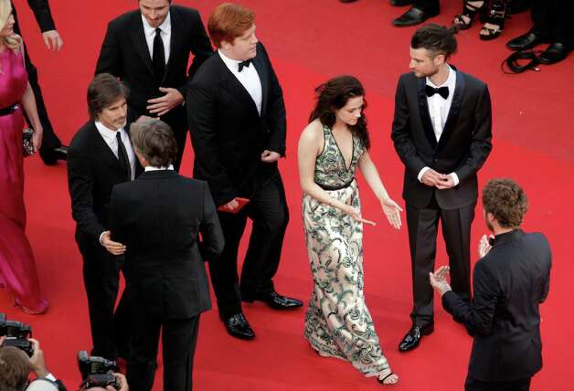 Actress Kristen Stewart, center, arrives -for the screening of On the Road at the 65th international film festival, in Cannes, southern France, Wednesday, May 23, 2012. Photo: Virginia Mayo, AP / AP