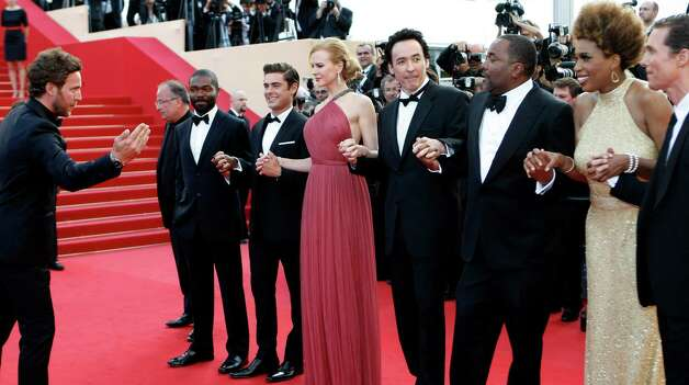 From third left, actors David Oyelowo, Zac Efron, Nicole Kidman, John Cusack, director Lee Daniels, Macy Gray and Matthew McConaughey are put into position on the red carpet as they arrive for the sc