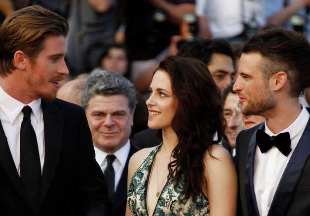 From left, actor Garret Hedlund, Kristen Stewart and Tom Sturridge arrive for the screening of On the Road at the 65th international film festival, in Cannes, southern France, Wednesday, May 23, 2012