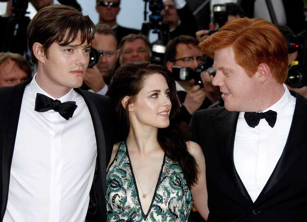 From left, actors Sam Riley, Kristen Stewart and Danny Morgan arrive for the screening of On the Road at the 65th international film festival, in Cannes, southern France, Wednesday, May 23, 2012. Pho