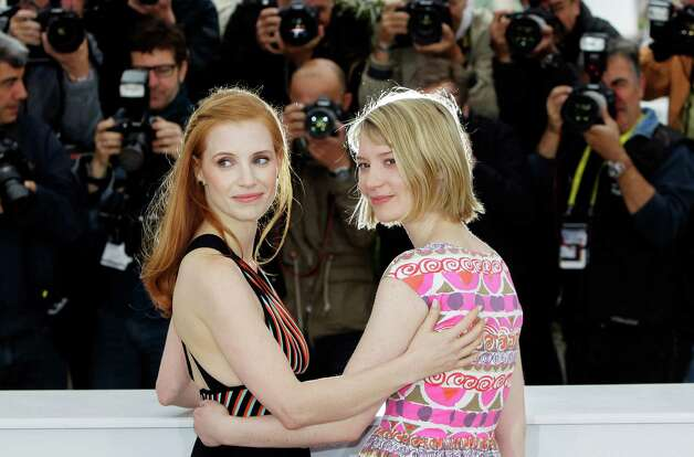 Actresses Jessica Chastain, left and Mia Wasikowska pose during a photo call for Lawless at the 65th international film festival, in Cannes, southern France, Saturday, May 19, 2012. Photo: Francois M
