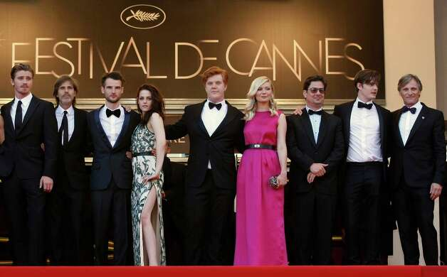 From left, actor Garret Hedlund, director Walter Salles, actors Tom Sturridge, Kristen Stewart, Danny Morgan, Kirsten Dunst, producer Roman Coppola, actors Sam Riley and Viggo Mortensen arrive for th