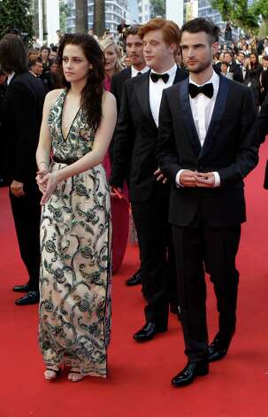From left actors Kristen Stewart, Danny Morgan and Tom Sturridge arrive for the screening of On the Road at the 65th international film festival, in Cannes, southern France, Wednesday, May 23, 2012.