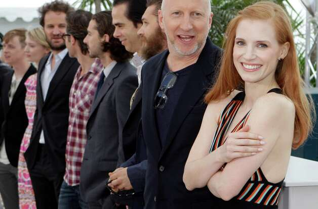 From right, actress Jessica Chastain, director John Hillcoat, actor Tom Hardy, screenwriter Nick Cave, actors Shia LaBeouf, Guy Pearce, Jason Clarke, Mia Wasikowska and Dane Dehaan pose during a phot