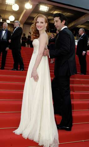 Actors Jessica Chastain, left and David Schwimmer arrive for the screening of Madagascar 3: Europe's Most Wanted at the 65th international film festival, in Cannes, southern France, Friday, May 18, 2