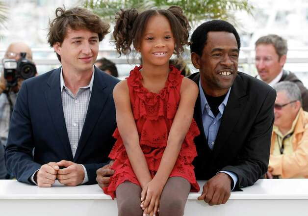 Director Benh Zeitlin, left and actors Quvenzhane Wallis and Dwight Henry pose during a photo call for Beasts of the Southern Wild at the 65th international film festival, in Cannes, southern France,