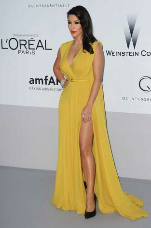 Kim Kardashian arrives for the amfAR Cinema Against AIDS benefit at the Hotel du Cap-Eden-Roc, during the 65th Cannes film festival, in Cap d'Antibes, southern France, Thursday, May 24, 2012. Photo: