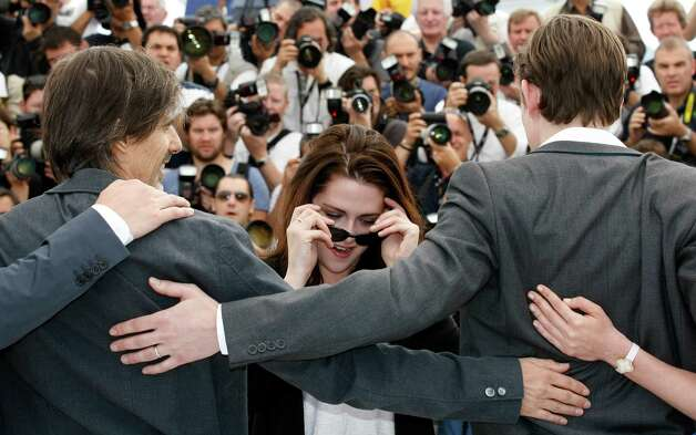 Director Walter Salles, left, actors Kristen Stewart and Sam Riley pose during a photo call for On the Road at the 65th international film festival, in Cannes, southern France, Wednesday, May 23, 201