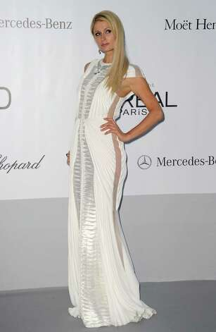 Paris Hilton arrives for the amfAR Cinema Against AIDS benefit at the Hotel du Cap-Eden-Roc, during the 65th Cannes film festival, in Cap d'Antibes, southern France, Thursday, May 24, 2012. Photo: Jo