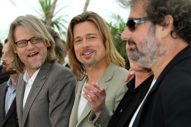 Director Andrew Dominik, left actor Brad Pitt, Ray Liotta, partially seen, and actor Gustave Kervern pose during a photo call for Killing Them Softly at the 65th international film festival, in Canne