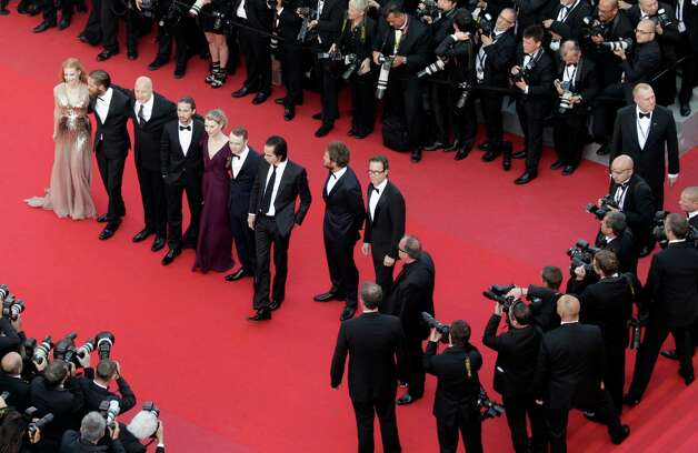 Cast members from left, Jessica Chastain, Tom Hardy, Director John Hillcoat, Shia LaBeouf, Mia Wasikowska, Dane Dehaan, screenwriter Nick Cave, Jason Clarke and Guy Pearce pose on the red carpet as t