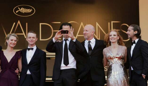 From left, actors Mia Wasikowska, Dane Dehaan, screenwriter Nick Cave, director John Hillcoat, actors Jessica Chastain and Shia LaBeouf arrive for the screening of Lawless at the 65th international f