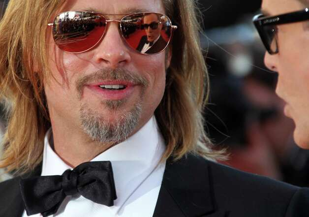 Actor Brad Pitt arrives for the screening of Killing Them Softly at the 65th international film festival, in Cannes, southern France, Tuesday, May 22, 2012. Photo: Joel Ryan, AP / AP