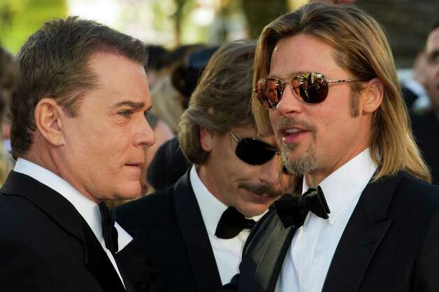 Actors Ray Liotta, left, Ben Mendelsohn, centre, and Brad Pitt arrive for the screening of Killing Them Softly at the 65th international film festival, in Cannes, southern France, Tuesday, May 22, 20