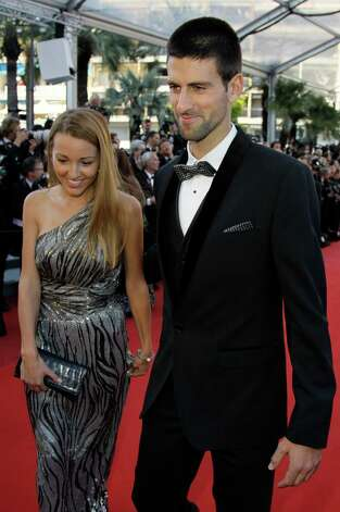 Tennis player Novak Djokovic, right, and Jelena Ristic arrive for the screening of Killing Them Softly at the 65th international film festival, in Cannes, southern France, Tuesday, May 22, 2012. Phot