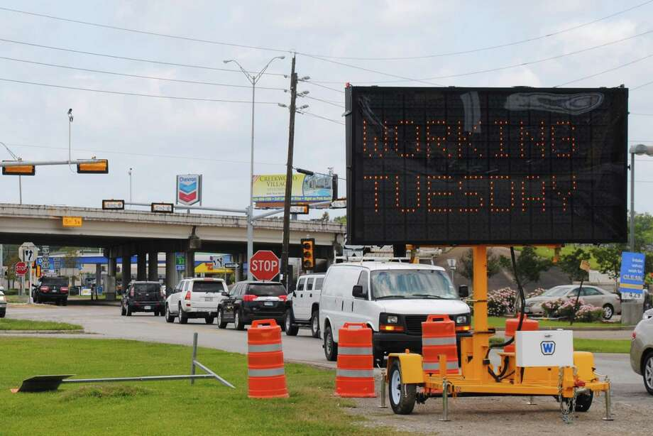 A digital sign at placed before the intersection at Texas 105 and Eastex Freeway alerts drivers the traffic signal will be operational Tuesday. Amos Morale III/The Enterprise Photo: Amos Morale III