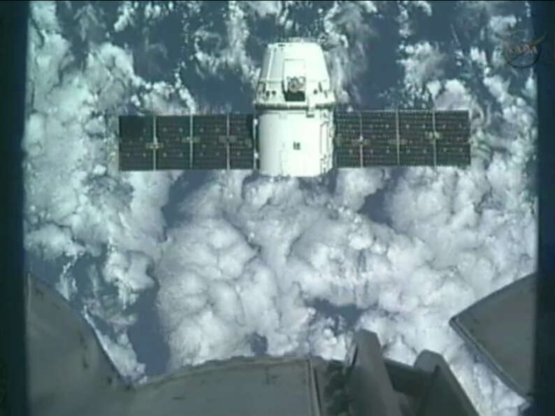 This image provided by NASA-TV shows the SpaceX Dragon commercial cargo craft taken from Canadarm2's
