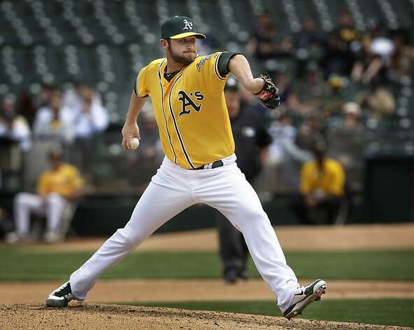 Oakland Athletics relief pitcher Ryan Cook pitches against the Chicago White Sox on Wednesday, April 25, 2012, at the O.co Coliseum in Oakland, Calif. Photo: Lea Suzuki, The Chronicle