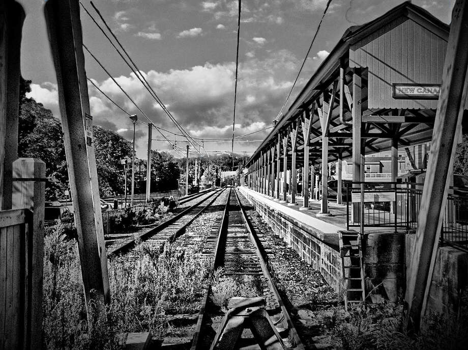 The photography of New Canaan resident Dutch Doscher will be on view at The Bank of New Canaanís Elm Street branch from Monday, June 4, through the end of August. Pictured is New Canaan Train Station in New Canaan, Conn. Photo: Contributed Photo