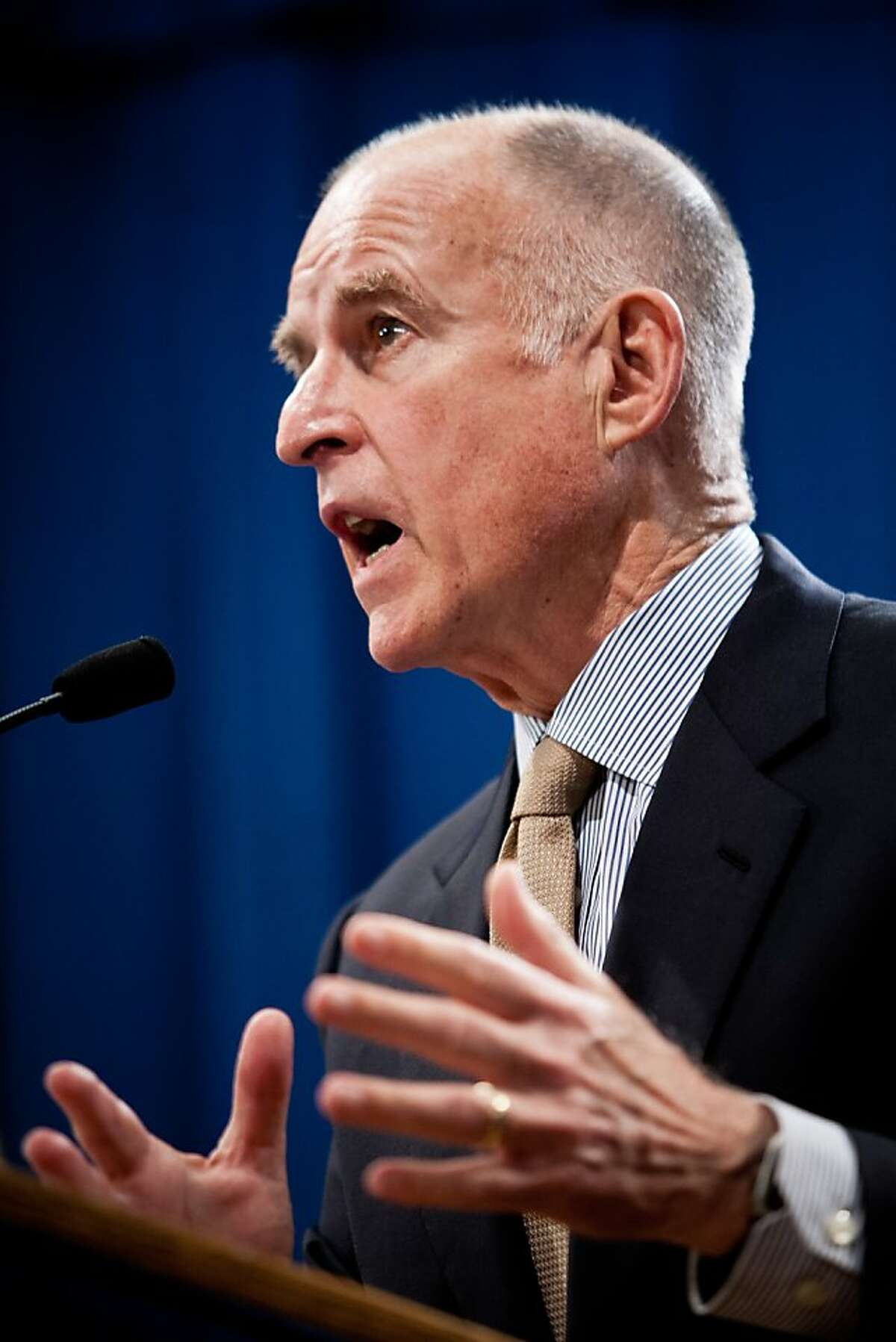 California Governor Jerry Brown announces his revised state budget, cutting an additional $8.3 billion in an effort to close the $15.7 billion deficit at the State Capitol in Sacramento, Calif., May 14, 2012.