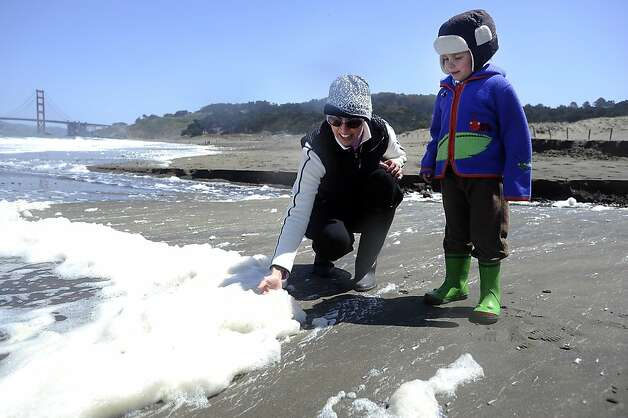 Jill Spangenberg and her son Stuart Barakos(4yrs) play with sea foam at Baker Beach.  Heal the Bay released it's annual report on California beaches and water quality at Baker Beach in San Francisco Thursday May 24th, 2012 Photo: Michael Short