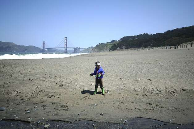 Stuart Barakos(4yrs) throws rocks into the creek that empties into the bay at Baker Beach.  Heal the Bay released it's annual report on California beaches and water quality at Baker Beach in San Francisco Thursday May 24th, 2012 Photo: Michael Short