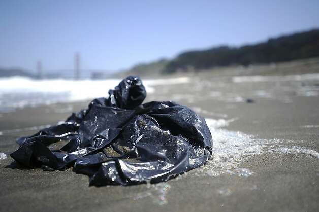 A plastic trash bag is seen wash up on the shore.  Heal the Bay released it's annual report on California beaches and water quality at Baker Beach in San Francisco Thursday May 24th, 2012 Photo: Michael Short