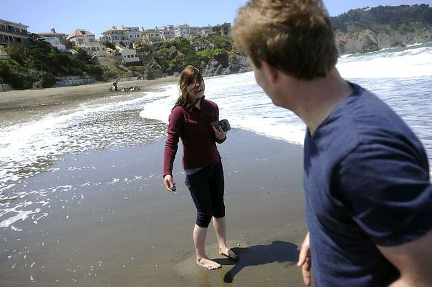 Angella Miller of Chicago and Jameson Baffmire of San Francisco get their feet wet as they skip rocks into the surf.  Heal the Bay released it's annual report on California beaches and water quality at Baker Beach in San Francisco Thursday May 24th, 2012 Photo: Michael Short