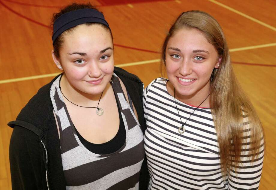 Greenwich High School freshmen Jenna, left, and Gianna DeMasi are two of the 18 sets of twins in their class, as seen on Friday, May 25, 2012. Photo: David Ames / Greenwich Time