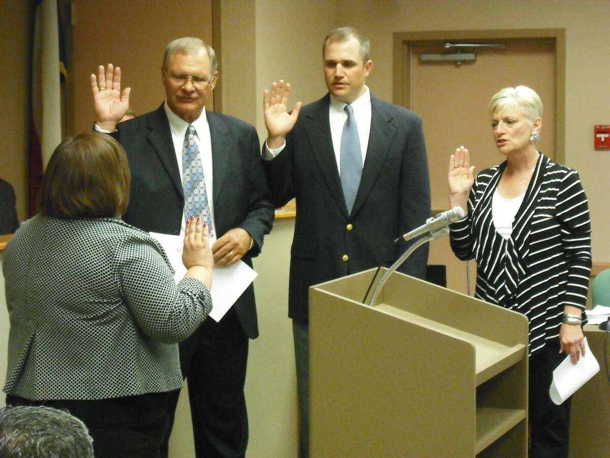Hollywood Park City Secretary Janice Alamia administers the oath of office to newly elected Mayor Bill Bohlke (from left), and City Councilmembers Matt Amerman and Sudie Sartor.