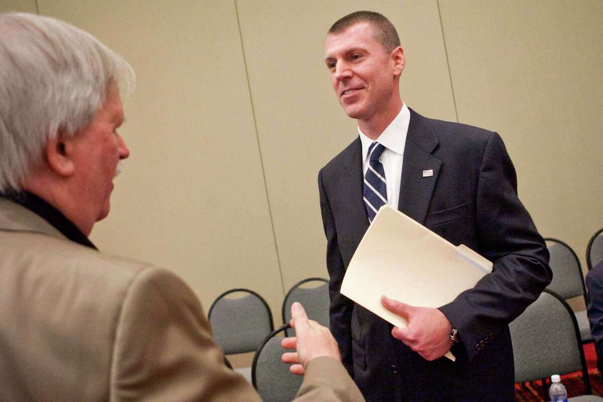 Republican candidate, Chris Meek, right, of Stamford, talks with Woodbury resident Chris Ford. Following Steve Obstinik's win in the Fourth Congressional District nominating convention May 18, 2012, Meek decided to drop out of the race Friday, May 25, 2012.