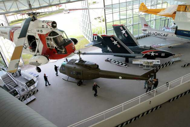 The Seattle Museum of Fight's 1970 Bell UH-1H 'Huey'  helicopter is rolled into the museum's main hall on May 25, 2012. Photo: Ted Huetter / The Museum of Flight, Seattle