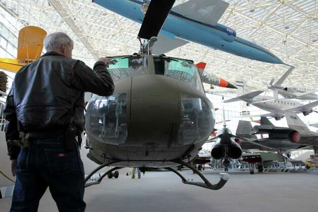 A staffer directs a crane moving the Seattle Museum of Fight's 1970 Bell UH-1H 'Huey'  helicopter to the center of the museum's main hall on May 25, 2012. Photo: Ted Huetter / The Museum of Flight, Seattle