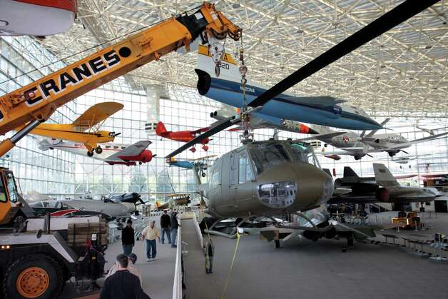 A crane moves the Seattle Museum of Fight's 1970 Bell UH-1H 'Huey' helicopter to the center of the museum's main hall on May 25, 2012. Photo: Ted Huetter / The Museum of Flight, Seattle