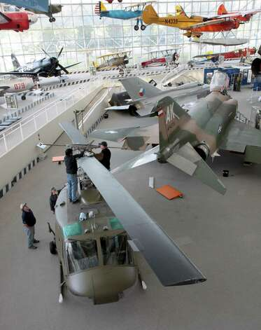 Workers finalize the rotor position of  the Seattle Museum of Fight's 1970 Bell UH-1H 'Huey' while readying it for display on May 25, 2012. Photo: Ted Huetter / The Museum of Flight, Seattle