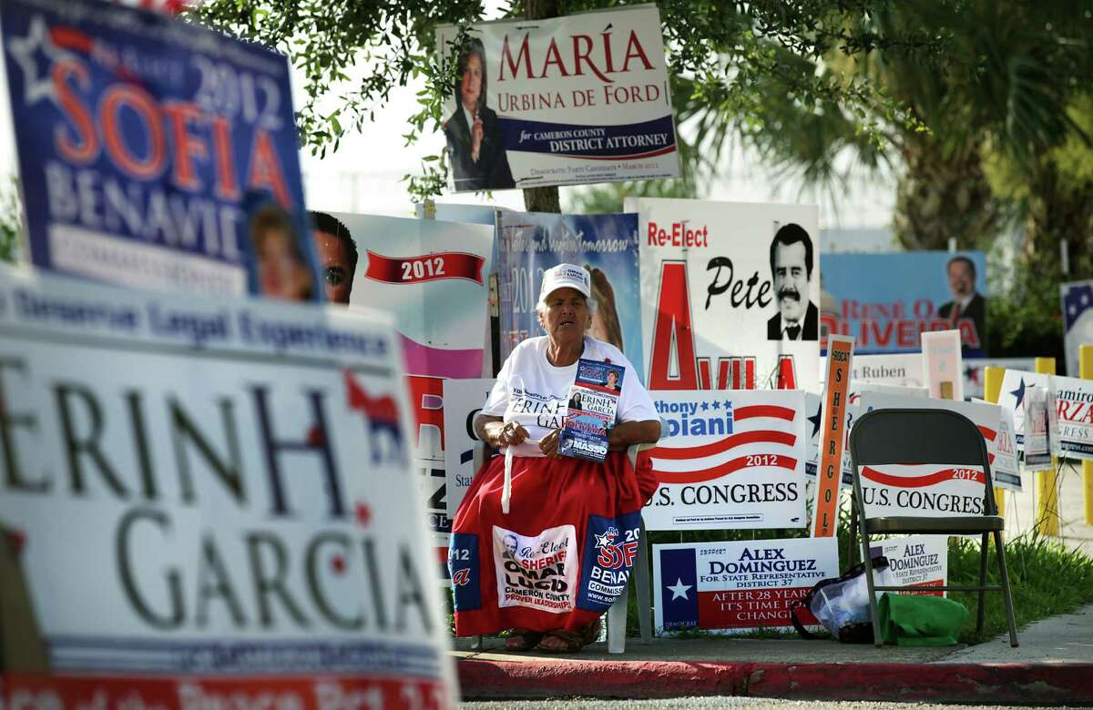 Herminia Becerra, the well known 83 year-old Politiquera in Brownsville, TX, works a polling site in front of Cameron County Courthouse during early voting. Thursday, May 17, 2012. Photo/Bob Owen