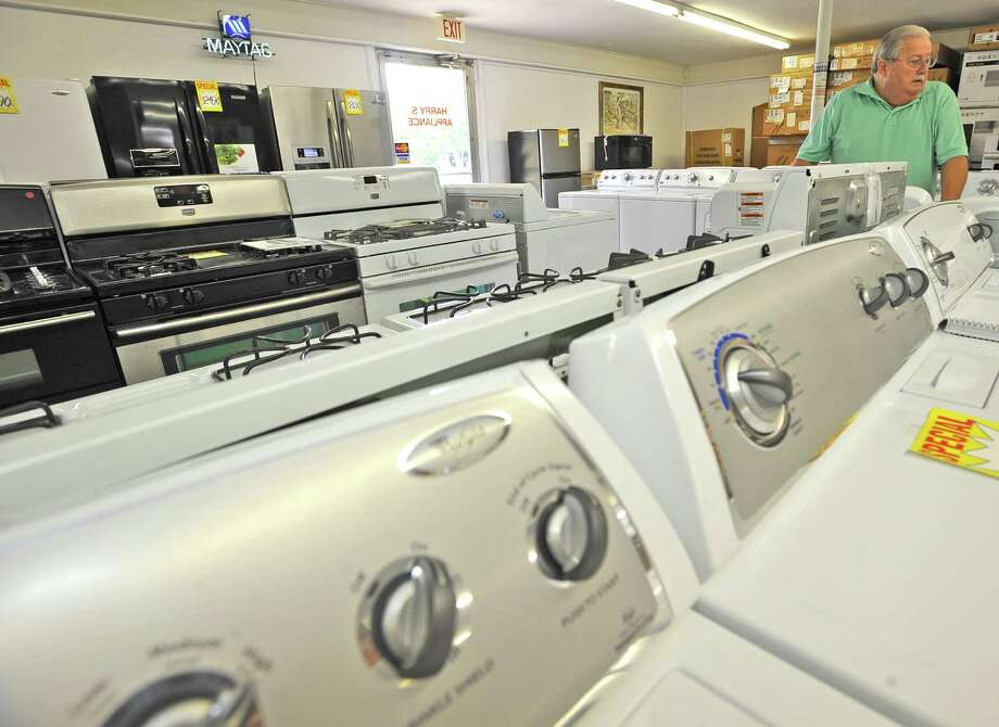 Harry Stephens talks about why he only carries American made products in his store Thursday morning May 24, 2012.  Harry's Appliance & Service Inc. in Orange has been in business for 49 years and only carries American-made products, like Whirlpool, KitchenAid, and Maytag, now.  And he hopes it might be that way if his grandson eventually takes over sometime in the future. One of Stephens' reasons for this is that parts for products made overseas aren't readily available and sometimes takes months to arrive. Dave Ryan/The Enterprise Photo: Dave Ryan
