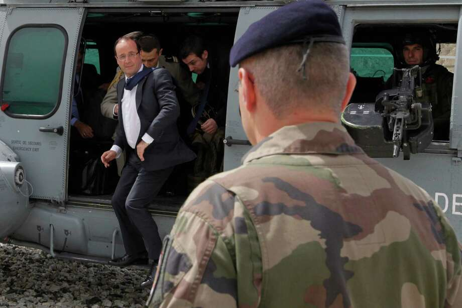 """French President Francois Hollande arrives Friday at Forward Operating Base Nijrab, in Kapisa, where most French troops are stationed in Afghanistan. """"What we want is that France has a presence in Afghanistan, but in a different way,"""" Hollande said at a joint news conference in the capital with Afghan leader Hamid Karzai. Photo: JOEL SAGET / AFP"""