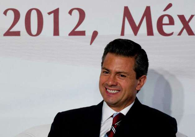 Enrique Pena Nieto, presidential candidate for the Institutional Revolutionary Party (PRI), smiles during a meeting with Mexican universities rectors in Mexico, Monday,  May 21, 2012. Pena Nieto, the front-running candidate in the race for Mexico's July 1 presidential election, is pledging to respect transparency and plurality if elected, things his Institutional Revolutionary Party was not known for during 71 years in power. Photo: AP