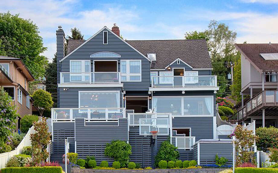 Is your dream to live on Lake Washington? How about in this home, 8750 Sand Point Way N.E., listed for $3.395 million? The 6,200-square-foot house has five bedrooms and 4.5 bathrooms, including a master suite with a fireplace and view deck, plus box beam ceilings, built-in cabinets, picture windows, French doors, fireplaces in the living, family and rec rooms and a high-end kitchen with an extra sink. The lot is nearly one-third of an acre, with a pool, hot tub, gas fire pit, multiple decks and a dock with a boathouse and two lifts. Photo: Courtesy Kim And Brad Knowles