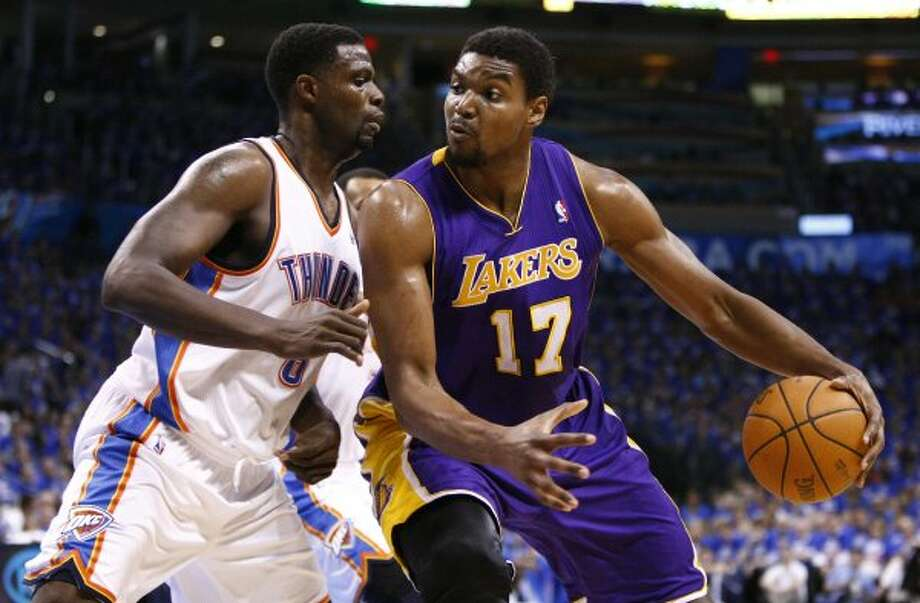 Lakers center Andrew Bynum (17) drives to the basket as Thunder's Nazr Mohammed (8) defends during the first half of Game 5 in their NBA basketball Western Conference semifinal playoff series, Monday, May 21, 2012, in Oklahoma City. Oklahoma City won 106-90 and advances to the Western Conference Finals. (AP Photo/Alonzo Adams) (AP)