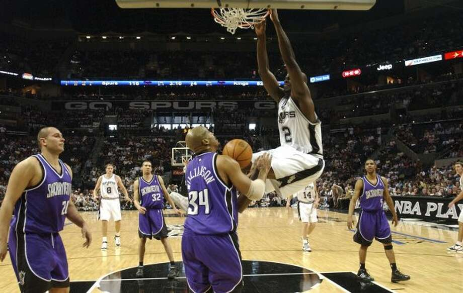 Spurs' Nazr Mohammed hangs on the rim after dunking over the Kings' Corliss Williamson Saturday April 22, 2006 during the first game in the first round of the Western Conference Playoff at the AT&T Center. The Spurs won 122-88. PHOTO BY EDWARD A. ORNELAS/STAFF (EDWARD A. ORNELAS / SAN ANTONIO EXPRESS-NEWS)