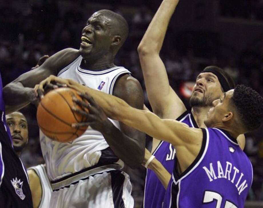 Nazr Mohammed is fouled by Kevin Martin in the first half of game one of the first round of the  Western Conference playoffs Saturday, April 22, 2006 at the AT&T Center. BAHRAM MARK SOBHANI/STAFF (BAHRAM MARK SOBHANI / SAN ANTONIO EXPRESS NEWS)