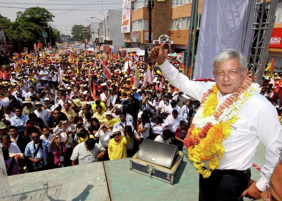 Mexican presidential candidate for the leftist coalition Progressive Movement of Mexico, Andres Manuel Lopez Obrador (R), greets supporters during a rally in Oaxaca, Mexico on April 29, 2012. AFP PHOTO/Carlos SalinasCARLOS SALINAS/AFP/GettyImages Photo: CARLOS SALINAS / AFP