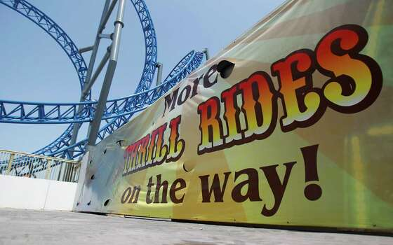 "A sign promising more rides ""on the way"" at the end of the new Pleasure Pier, May 2012. Photo: Karen Warren, Houston Chronicle / © 2012  Houston Chronicle"