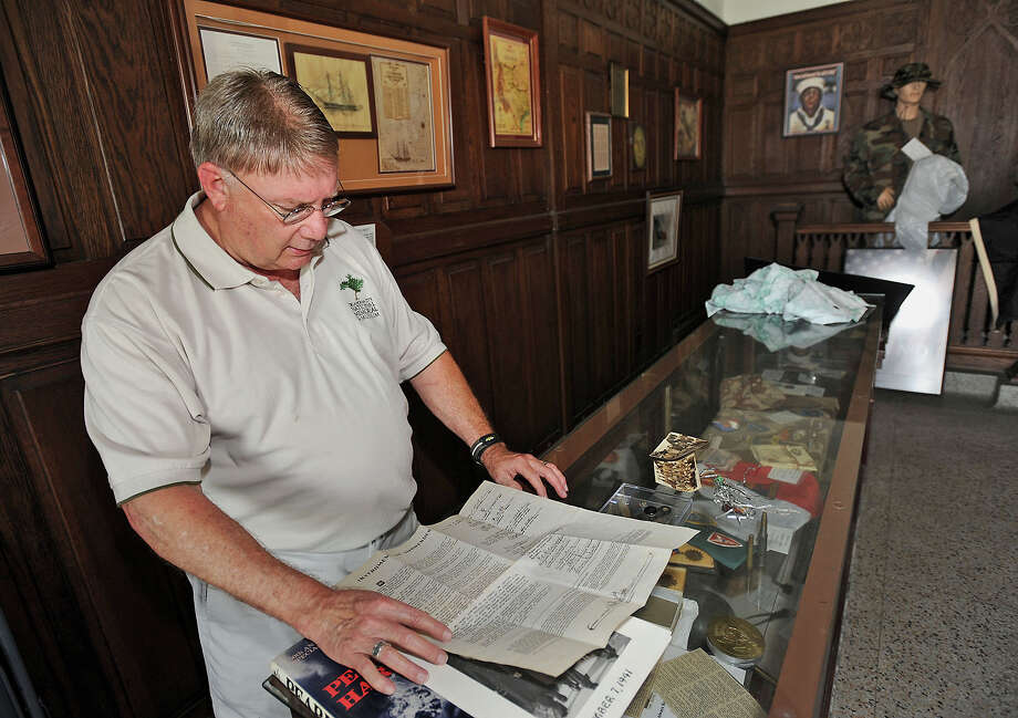 Dennis White talks about the historic pieces found at the Temple to the Brave in Beaumont. The memorial is open the public only five times a year and will be open on Memorial Day. Photo taken Thursday, May 24, 2012 Guiseppe Barranco/The Enterprise Photo: Guiseppe Barranco, STAFF PHOTOGRAPHER / The Beaumont Enterprise