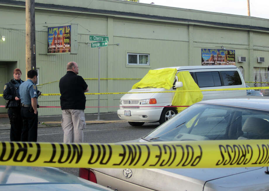 The Volkswagen van at Martin Luther King Junior Way and East Cherry Street shortly after the May 24 random shooting that killed Justin Ferrari, a father and Zillow.com developer who was driving with his family. Photo: Casey McNerthney/seattlepi.com