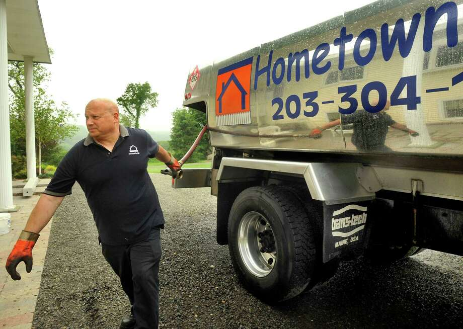 Rich Paltauf owner of Hometown Fuel in Newtown makes a delivery on Thursday, May 24, 2012. Photo: Michael Duffy / The News-Times