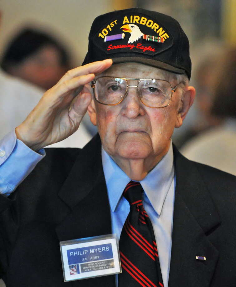 Phillip Myers of Saratoga Springs, a D-Day paratrooper with the 101st Airbourne Division, salutes during a D-Day survivors reunion June 4, 2011, in Colonie. (John Carl D'Annibale / Times Union)